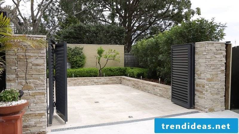 Garden gate itself build combination between natural stones and metal
