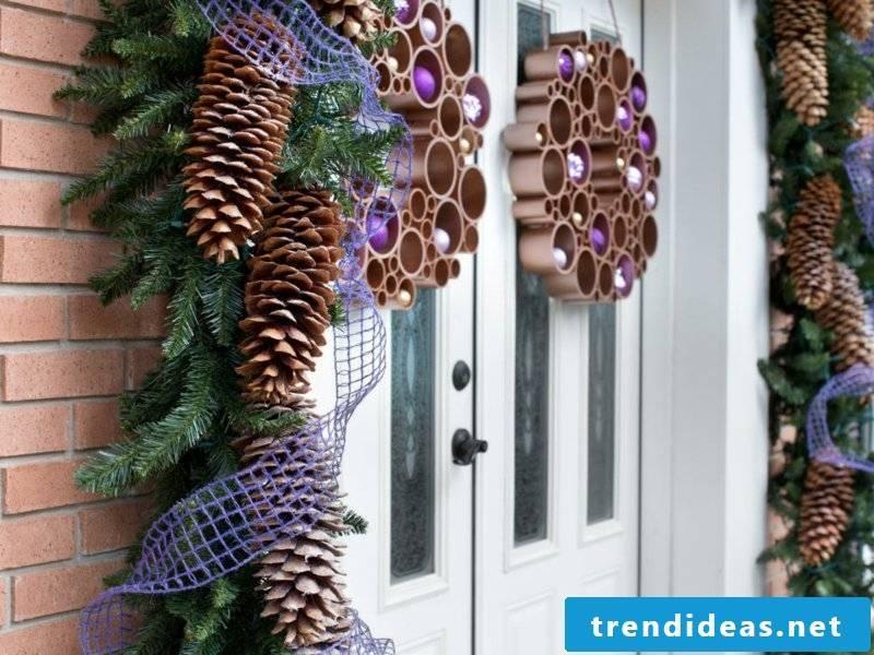 Decorate with pine cones the front door
