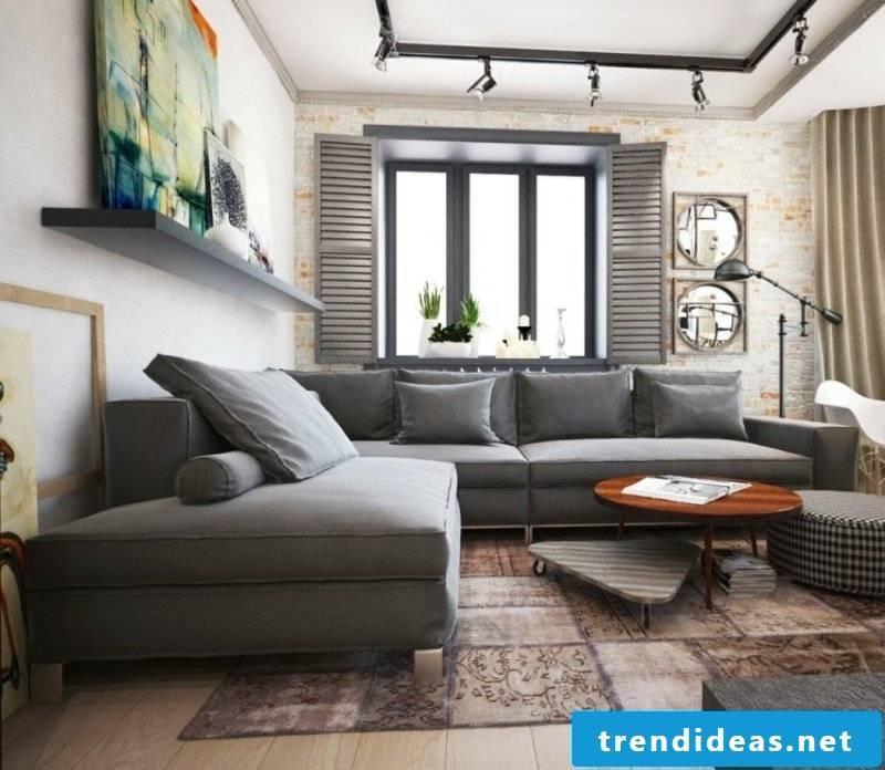 Living room with soft carpet and gray sofa