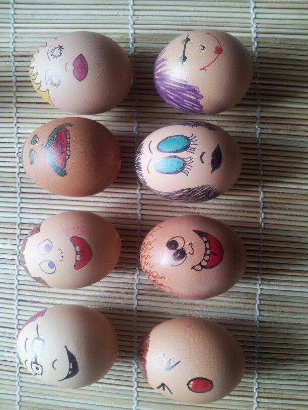 Funny eggs making faces for Easter