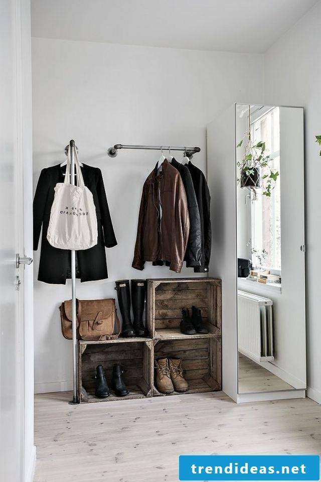 The entrance area is designed with the help of a beautiful wardrobe