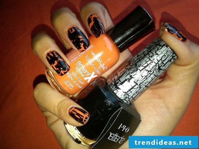 interesting nail design in black and orange Halloween