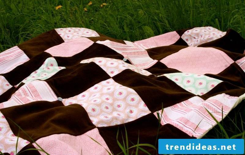 Sew on patchwork blanket for picnic