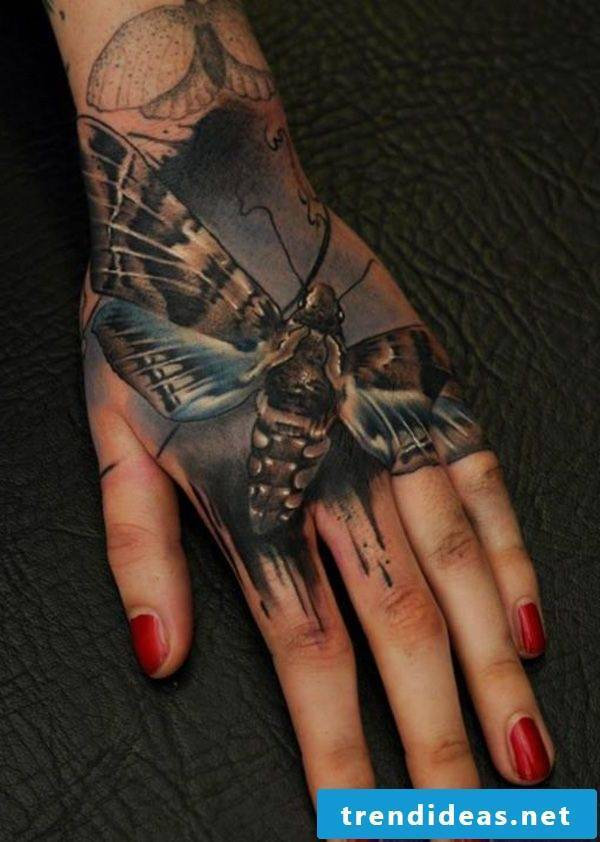Tattoo butterfly hand