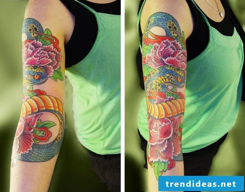 Japanese snake tattoo is drawn with bright colors