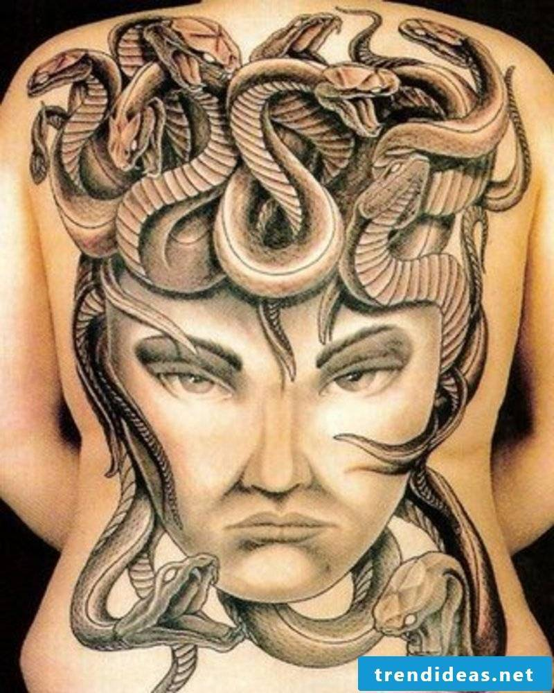 Snakes tattoo forms God