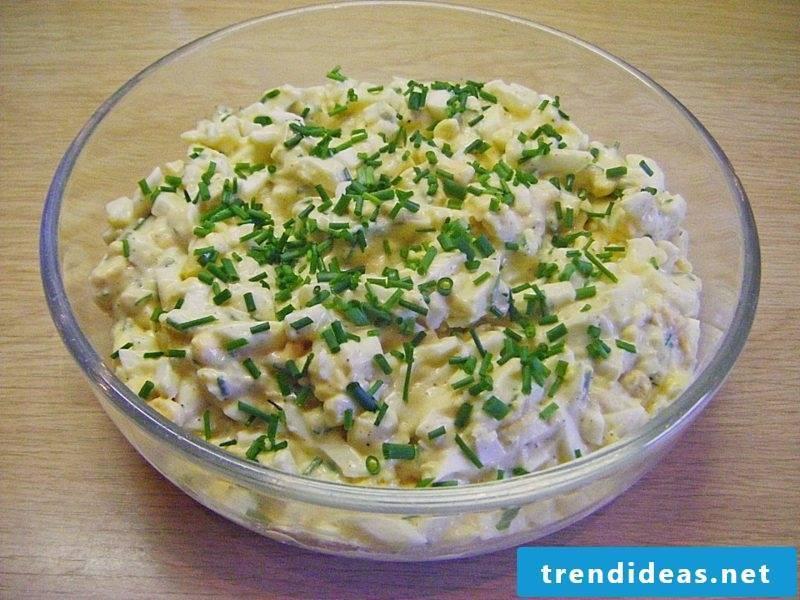 Preparing egg salad with ham
