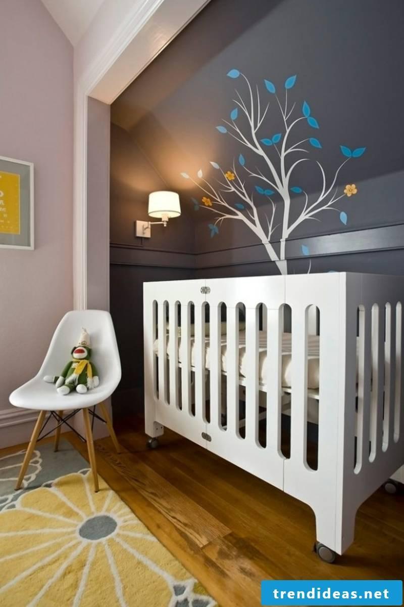 Nursery with dark wall paint