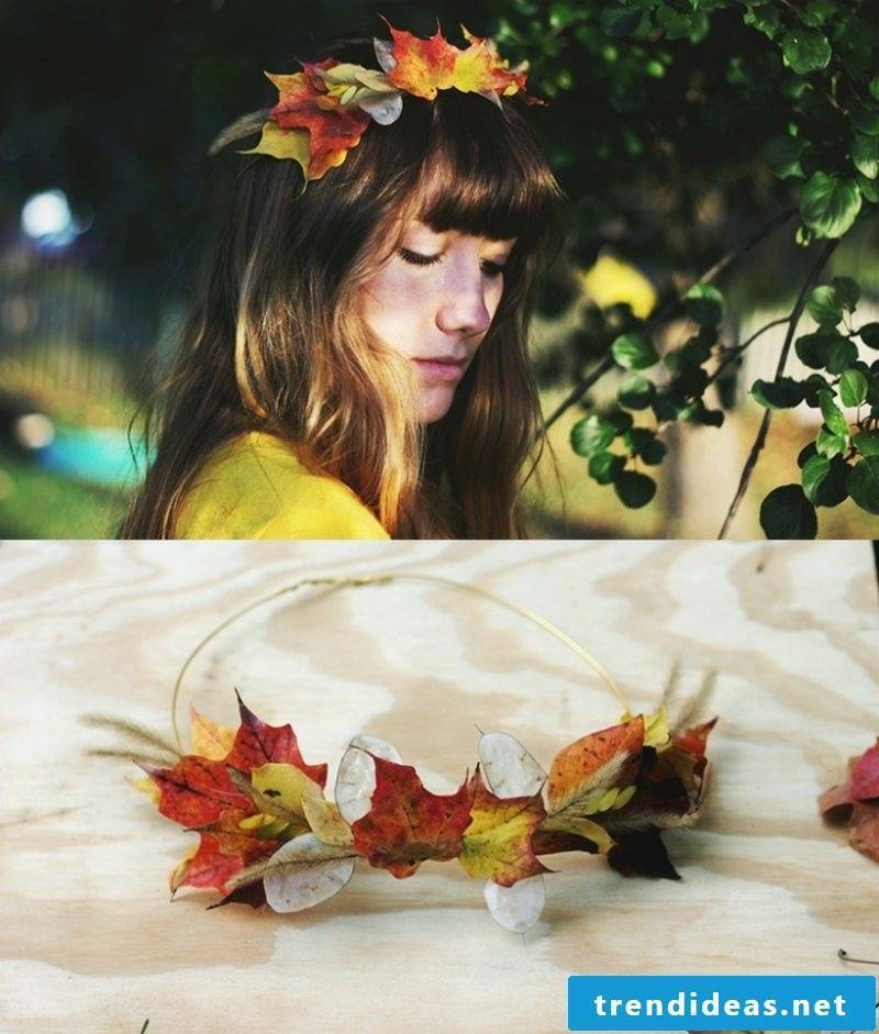 Tinker with children Autumn crown from colorful leaves