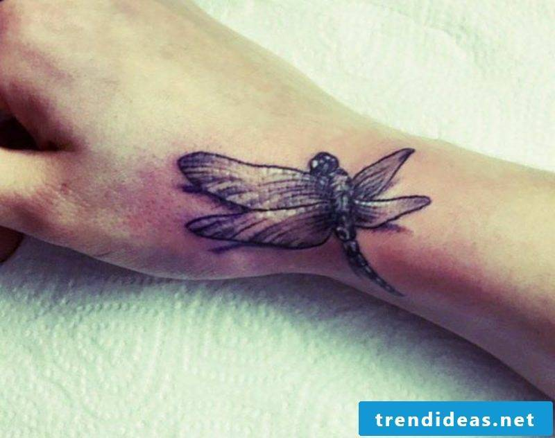 Dragonfly tattoo hand