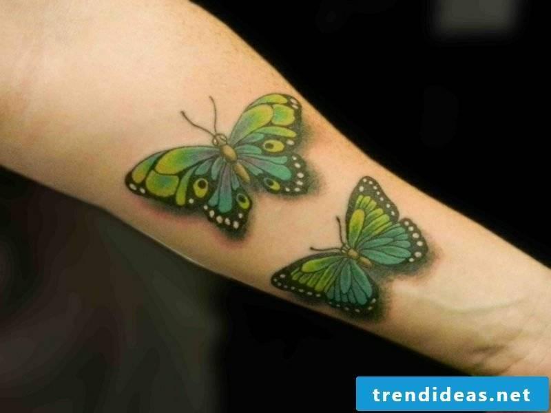 two butterflies tattoo forearm