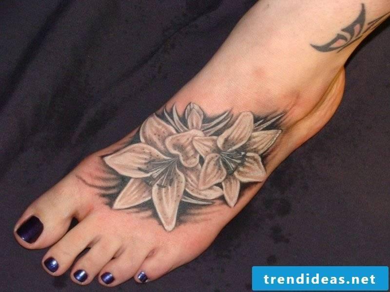 beautiful lilies tattoo on the foot