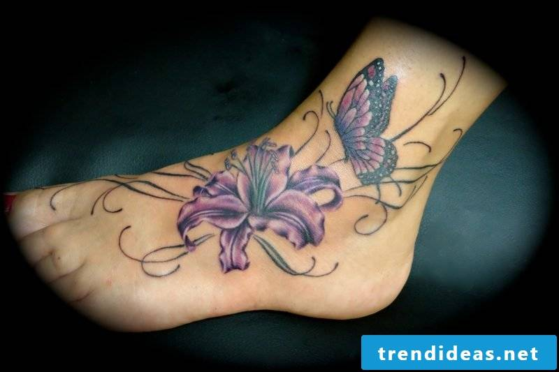 Butterfly and lily tattoo on the foot