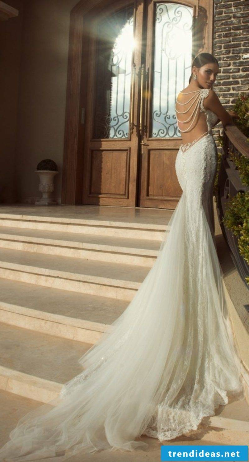 long wedding dress accent in the back