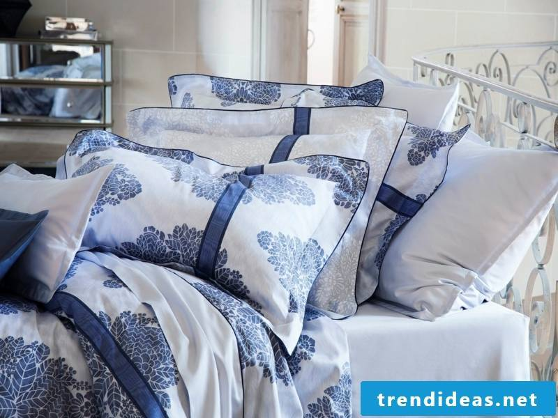 blue accents on the luxurious bed linen