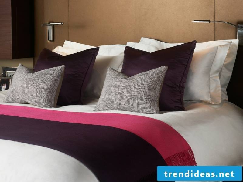 designer purple and pink accents on the luxury bedding