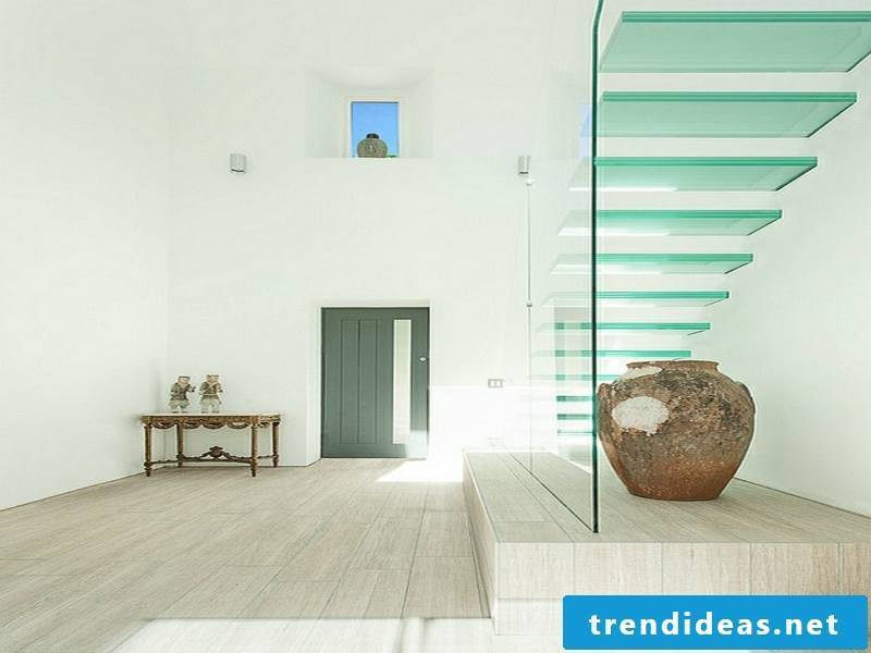 modern glass staircase and minimalist decor