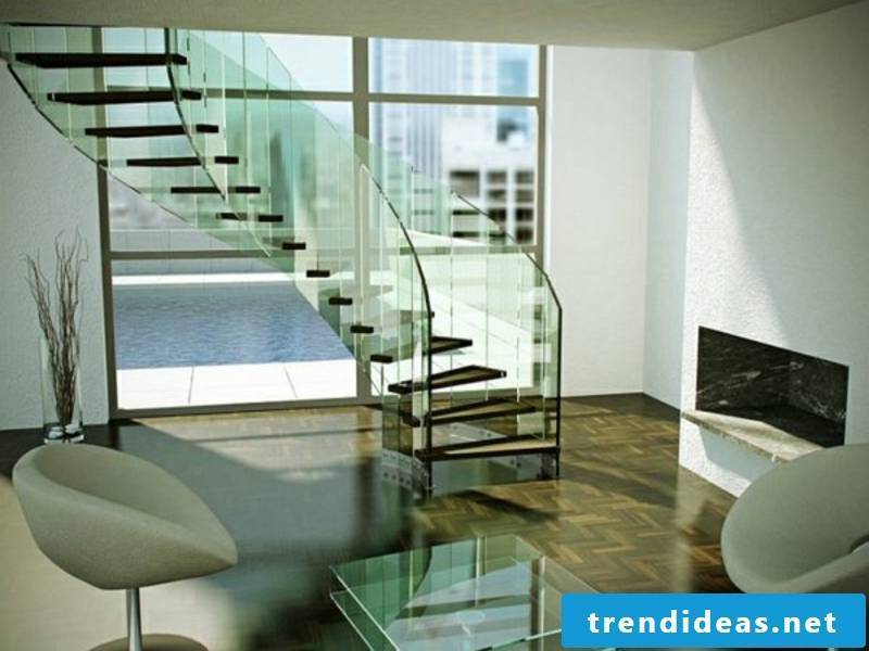 armchairs next to the modern glass staircase