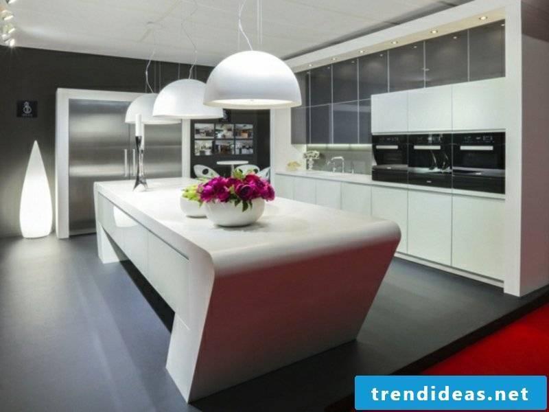 white trapezoidal kitchen island