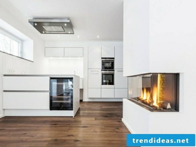 beautiful kitchen island next to the fireplace