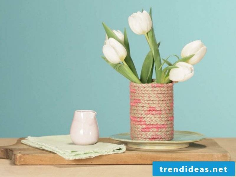 five white tulips in a homemade vase