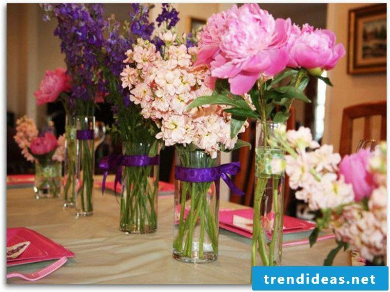 Numerous vases with flowers on the table