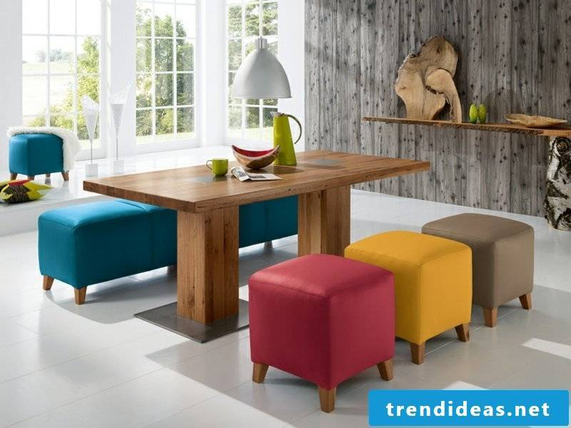 small classic dining lamps and colorful chairs