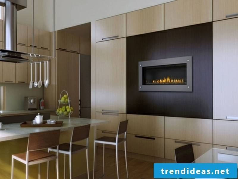 Gas fireplace on the wall in the kitchen