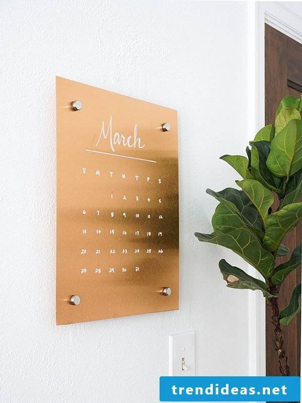 Stylish organization: calender in copper color as a wall decoration
