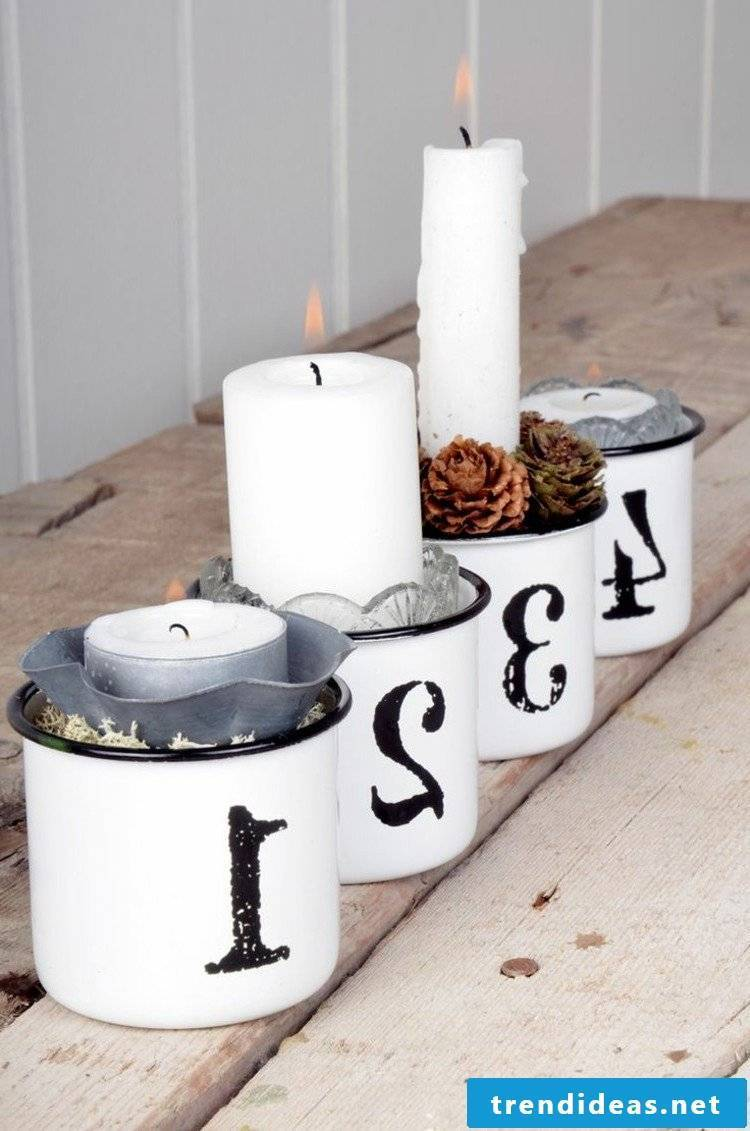 Advent wreath - order candles and pine cones and shape them into cups