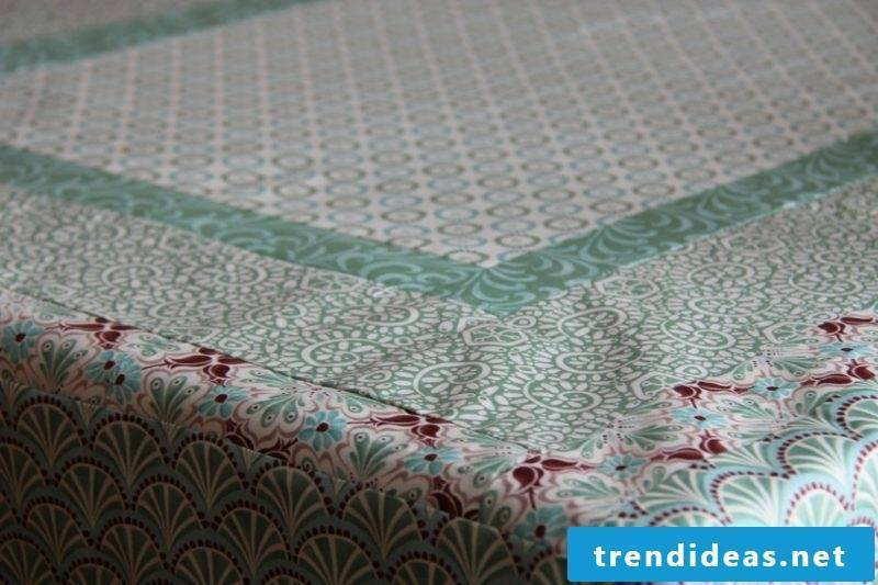 tablecloth near patchwork tablecloth