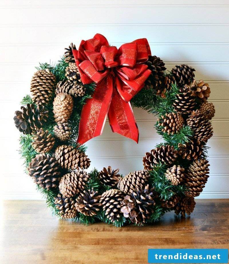 Tinker with pinecone cone wreath