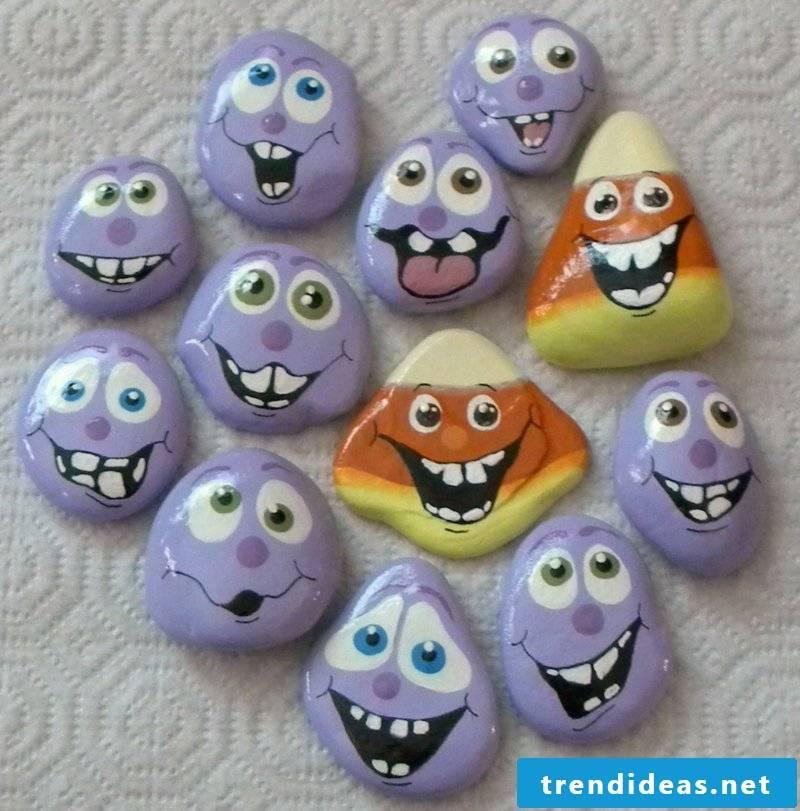 painted stones in purple