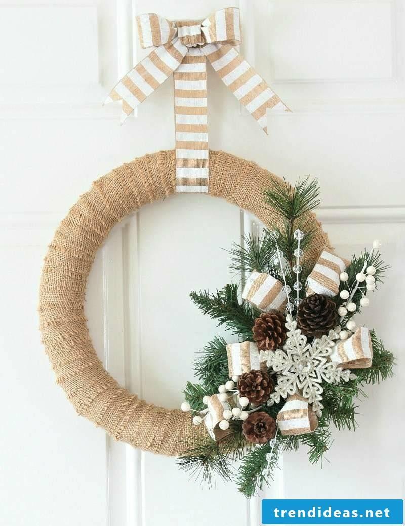 Tinker with pine cones door wreath
