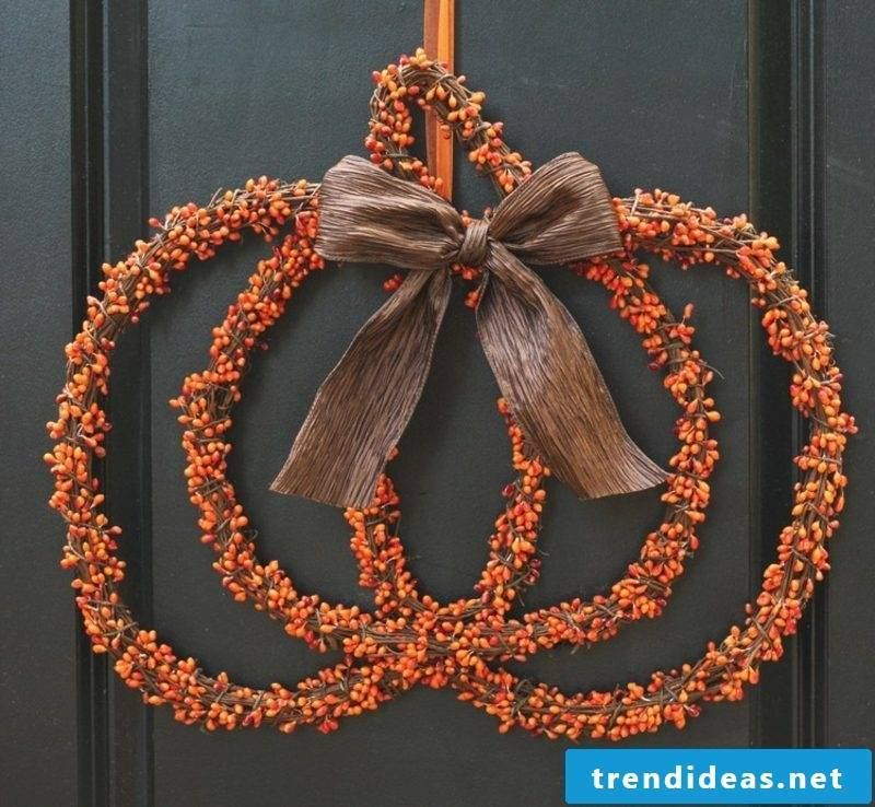 Autumn decoration for the entrance door wreath original pumpkin