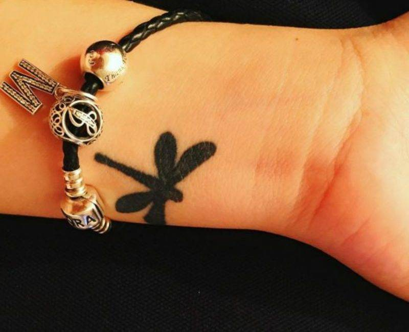 little dragonfly tattoo on the wrist