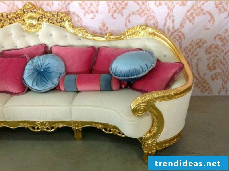 Baroque style sofa with colorful cushions