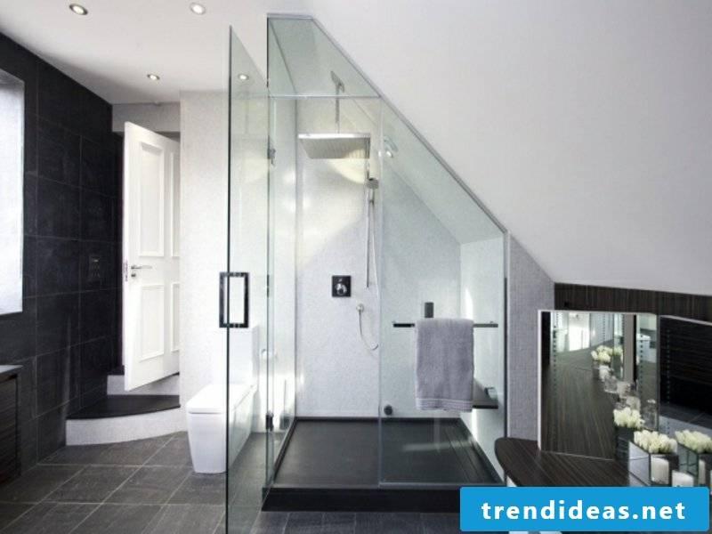 designer glass shower cabin and gray floor tiles