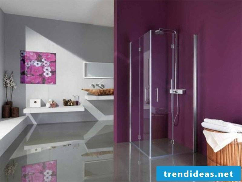 great shower cabin made of glass and purple walls