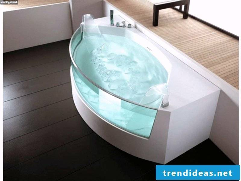 freestanding glass bathtub with white elements