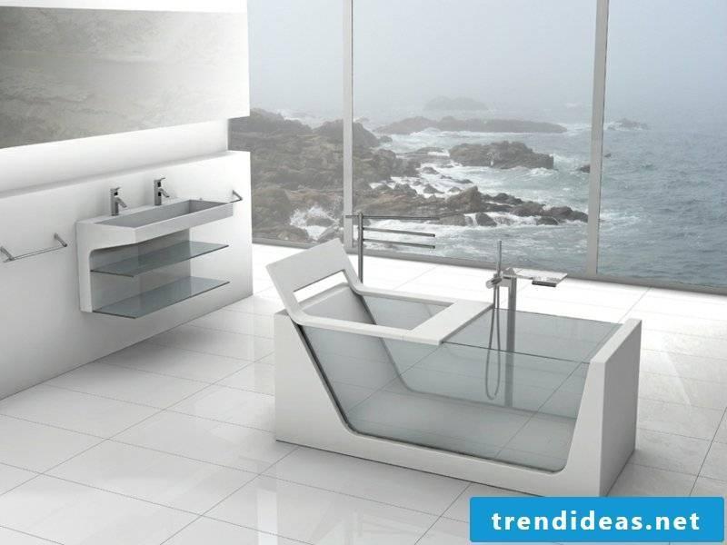 white bathroom with glass bathtub