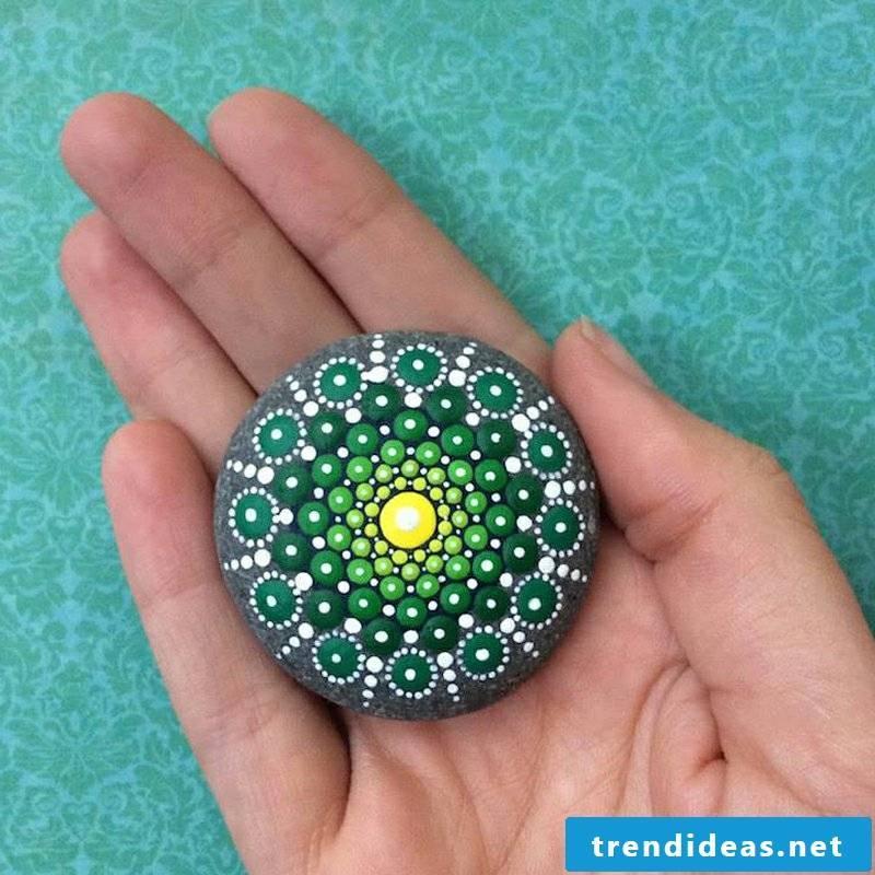 painted stones mandala in green