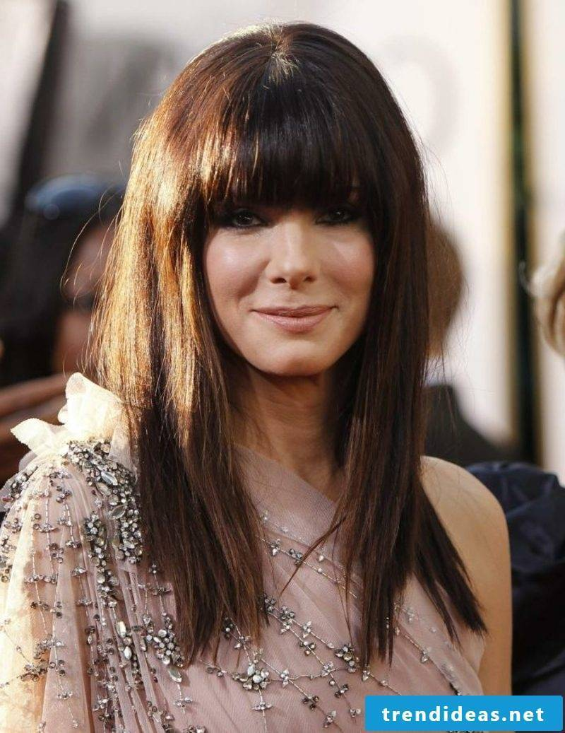 middle brown hair pony volume falling in the face Sandra Bullock