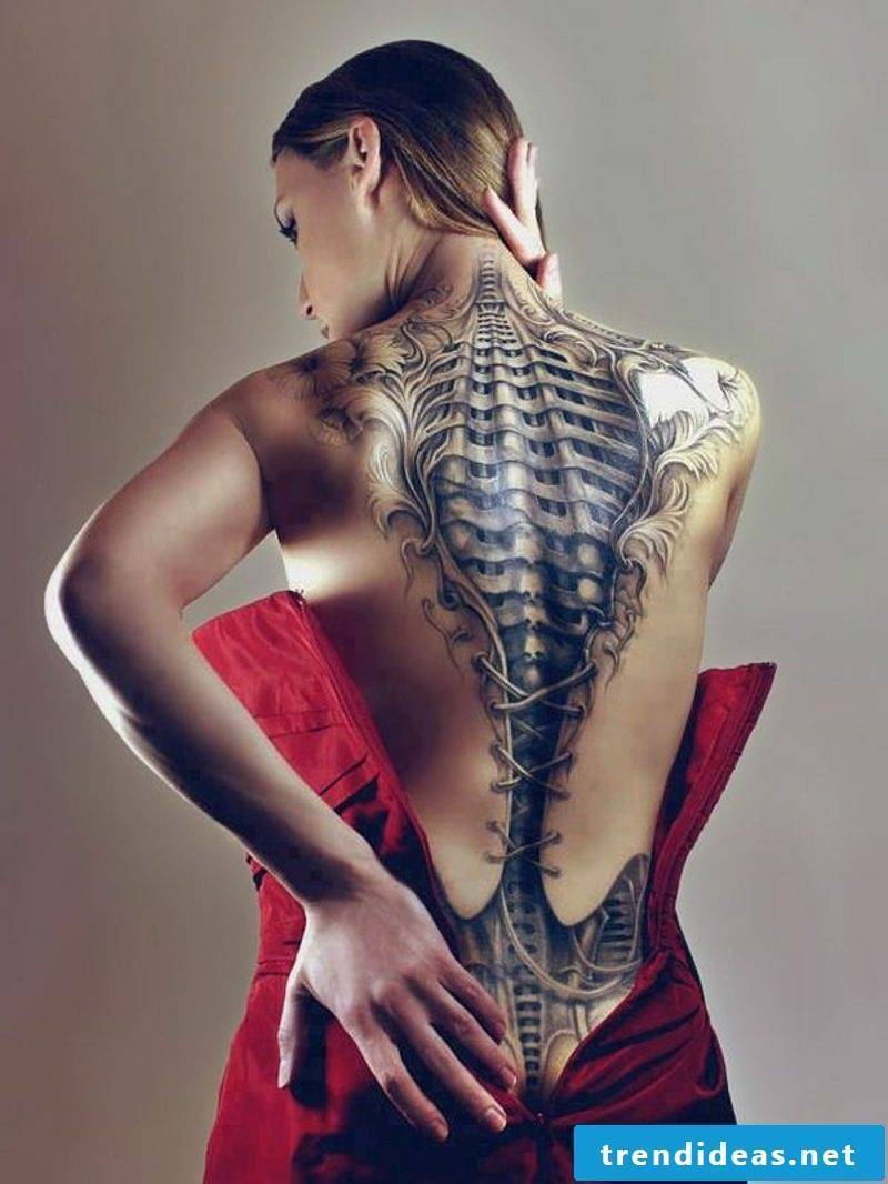 woman biomechanics tattoo back