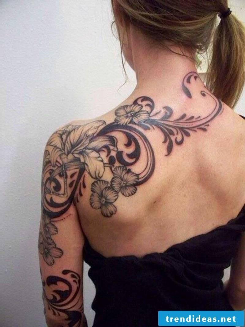 Interesting flower tendril tattoo back shoulder arm