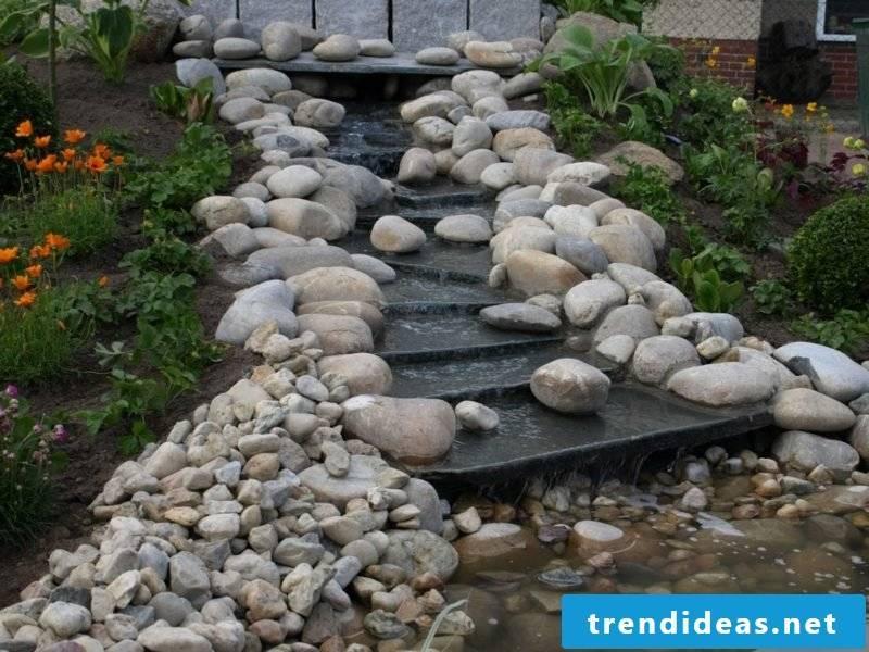 Bachlauf Steindeko creative garden design