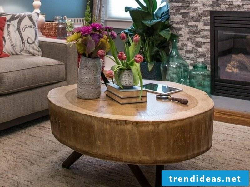 Table made of tree trunk with metal frame