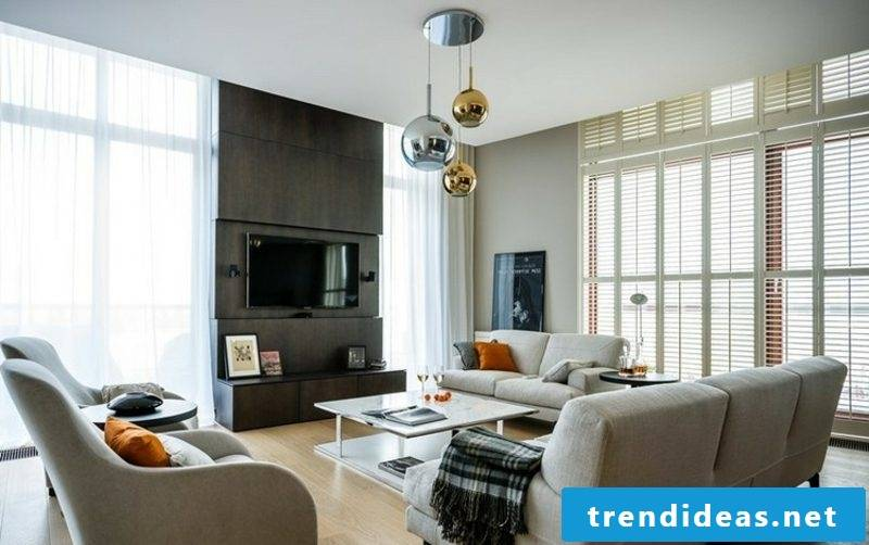 TV wall in anthracite gray living room interesting look