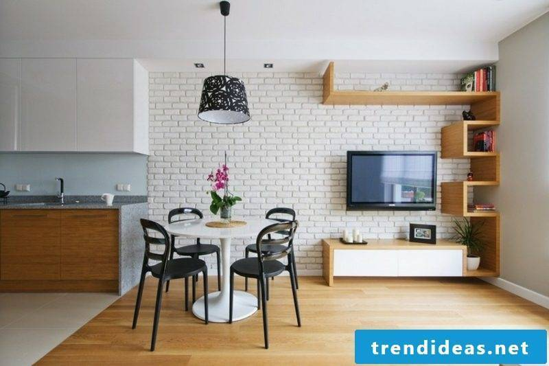 Tv mounted on the wall white brick wall glorious look dining area