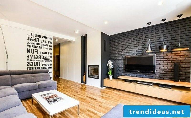 TV wall in the living room black bricks accent in the interior